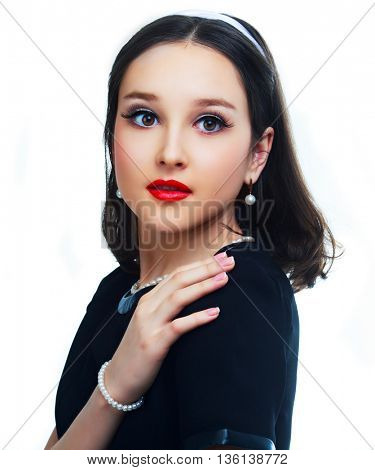 beautiful  girl with retro makeup, isolated against white studio background