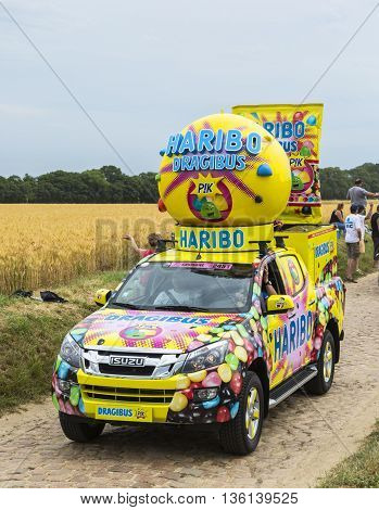 Quievy, France - July 07 2015: Haribo vehicle during the passing of the Publicity Caravan on a cobblestoned road in the stage 4 of Le Tour de France on July 7 2015 in Quievy France. Haribo is the biggest manufacturer of gummy and jelly sweets in the world
