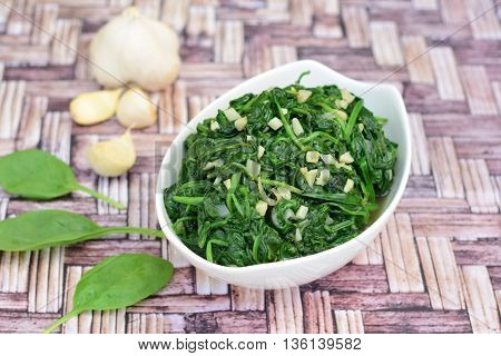 Homemade sautéed spinach with garlic in a bowl