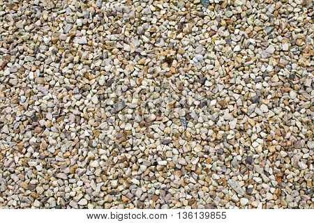 Gravel driveway background texture with small pebbles