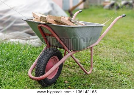 metal wagon with the wood in the vegetable garden