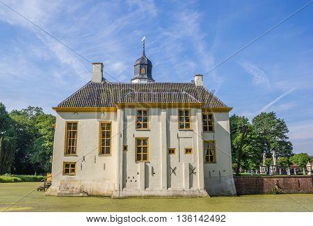 SLOCHTEREN, NETHERLANDS - JUNE 3, 2016: Old dutch mansion Fraeylemaborg in Slochteren, Netherlands