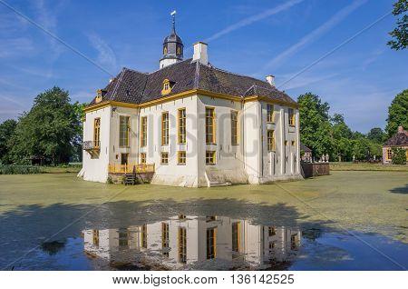 SLOCHTEREN, NETHERLANDS - JUNE 3, 2016: Old dutch mansion Fraeylemaborg with reflection in the water in Slochteren, Netherlands