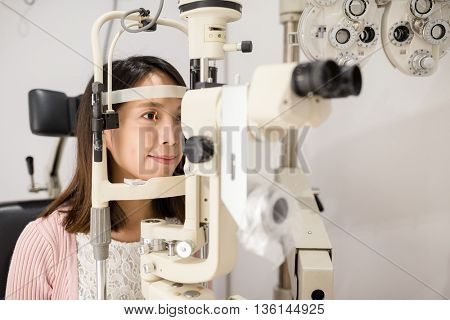 Young woman is having eye exam