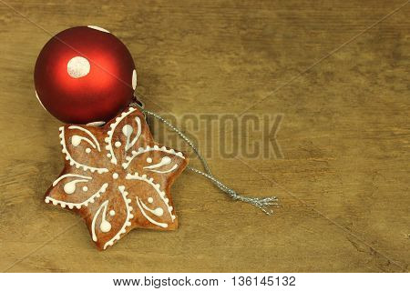 Gingerbread with white pattern in detail on wooden background