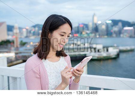 Woman use of smart phone at Hong Kong