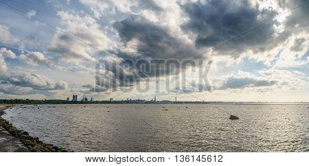 TALLINN ESTONIA - JUNE 19 2016: Summertime Tallinn city panorama. Scenic cloudscape over Baltic sea bay.