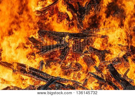 Big bonfire closeup beautiful red fire flames and firewood background