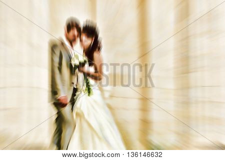 Wedding. Radial zoom blur effect defocusing filter applied with vintage instagram look.