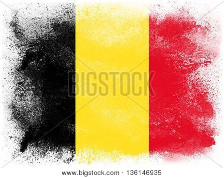 Powder paint exploding in colors of Belgium flag isolated on white background. Abstract particles explosion of colorful dust.