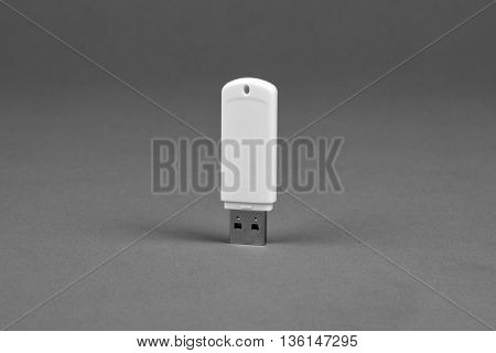 White usb flash drive on gray background