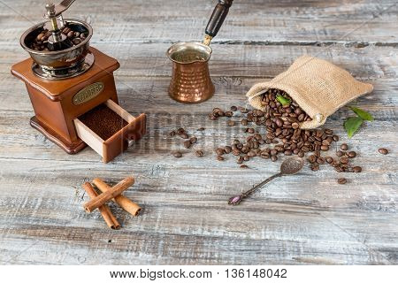 Still life coffee and coffee bean with coffee grinder on wooden board