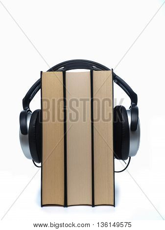 Books with headphones on a white background