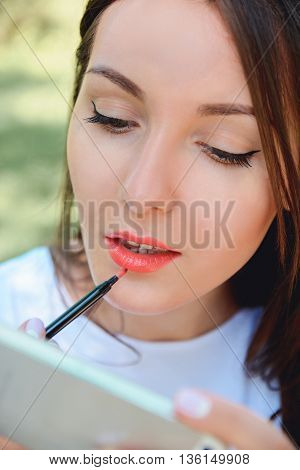 Woman Rouge Lips And Looking At Telephone As Mirror