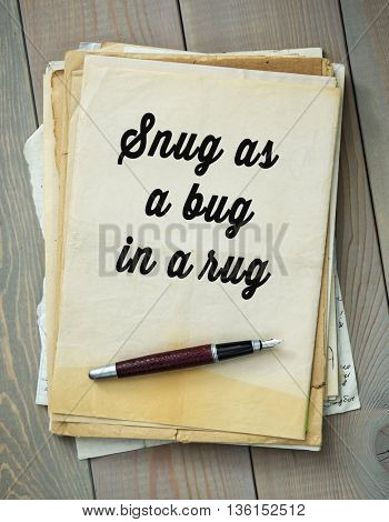 Traditional English proverb.  Snug as a bug in a rug