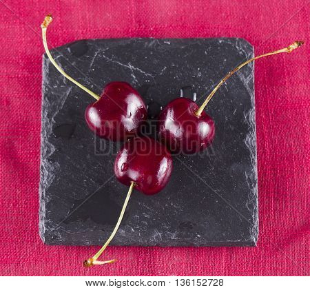 Three Cherries Over Red