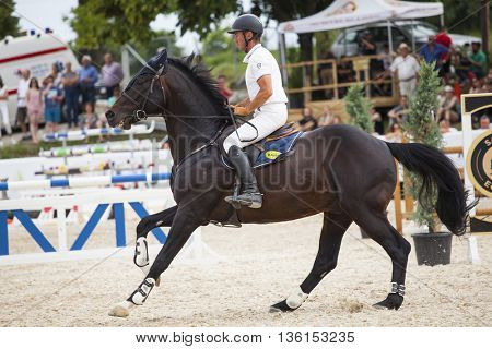 Turda, Cluj, Romania - June 18, 2016: An unidentified competitor jumps with his horse at the Salina Equines Horse Trophy , June 18, 2016 in Turda, Romania