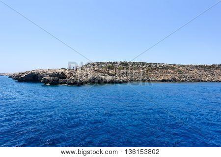 Pirate bay in protaras paralimni white church blue sea and rocks cyprus island