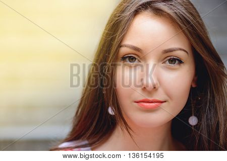 Smiling Woman Outdoors Backlit By Sun.