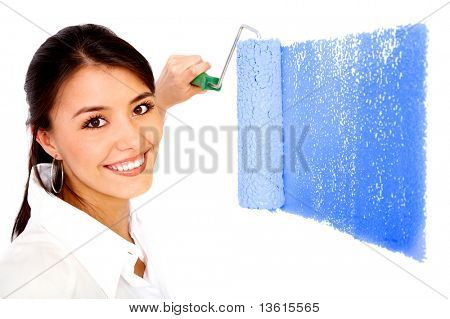 beautiful woman painting a wall with a roller - isolated over a white background