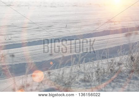 Car track in the snow in the winter
