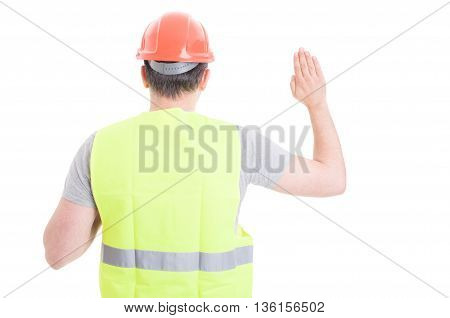 Back View Of Male Constructor Standing And Doing A Vow