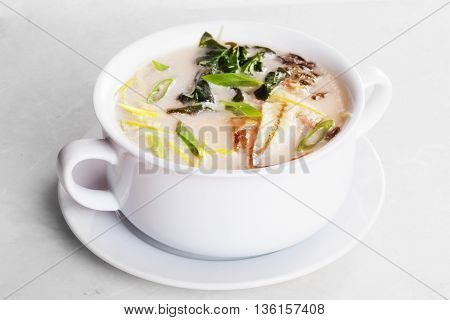 Miso soup with eel isolated in a pot of white background