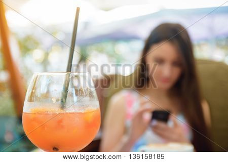 Cocktail In Cafe Focus, Woman On Background