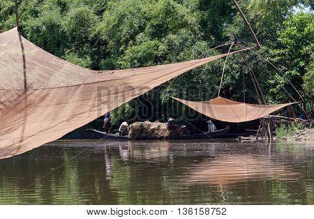 Hue, Vietnam, May 12, 2016 farmers, boating, Tam Giang lagoon, Hue