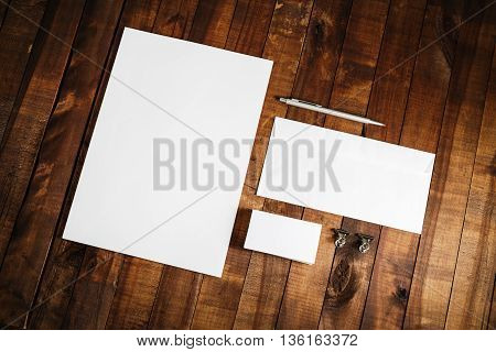 Photo of blank stationery set on vintage wooden table background. Template for branding identity. Mock-up for ID. Responsive design template. Blank template for your design.