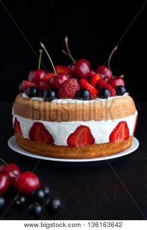 Strawberry cake traditional homemade gourmet sweet dessert bakery food with berries and whipped cream in dark food photo style