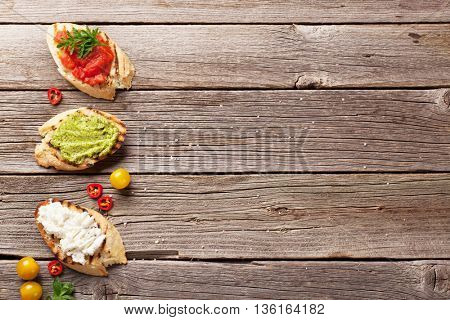 Toast sandwiches on wooden background. Top view with copy space