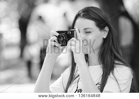 Young Woman Making Photos With Vintage Film Camera At Summer Green Park.