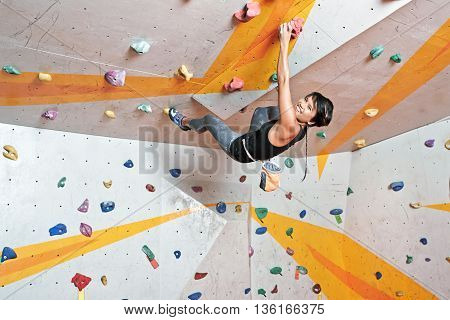Vietnamese young climber having training in indoor gym