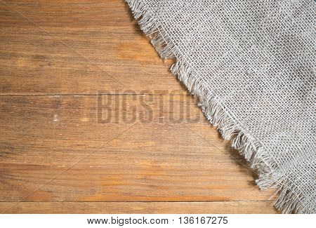 image of burlap texture on a wooden table