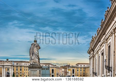 Main catholic square in Vatican city with sculptures of saints, evening time.