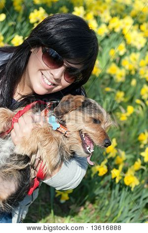 Woman And Her Dog In The Spring Time