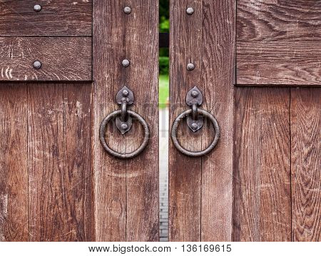 Old wooden gate with rings closeup shot