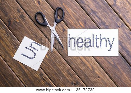 cut paper with word unhealthy