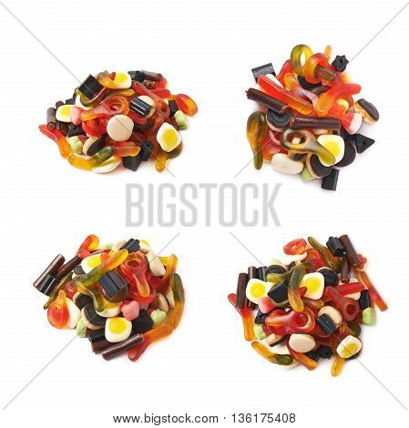 Pile of multiple colorful gelatin and licorice based candies isolated over the white background, set of four different foreshortenings
