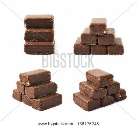 Pyramid made of chocolate coated candies isolated over the white background, set of four different foreshortenings