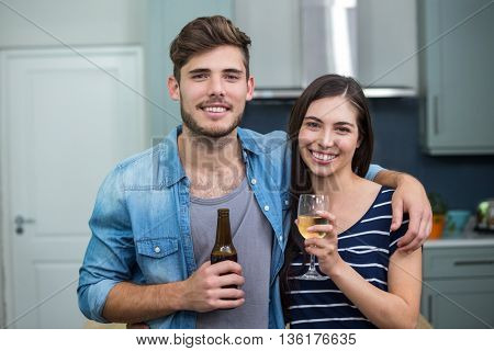 Portrait of happy friends enjoying drinks at home