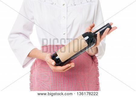 Unrecognizable woman in apron holding bottle of wine.Studio shot