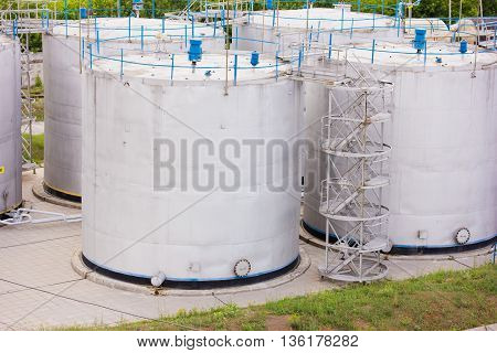 large white tanks for petrol and oil