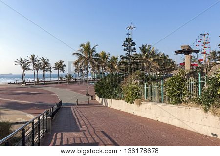 Paved Walkway Leading Down Onto Promenade Beach And Ocean
