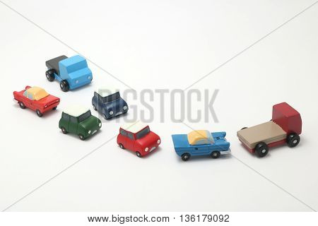 Miniature toy cars on white background.Traffic congestion.