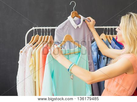 Fashionista looking at two dresses and choosing what to wear