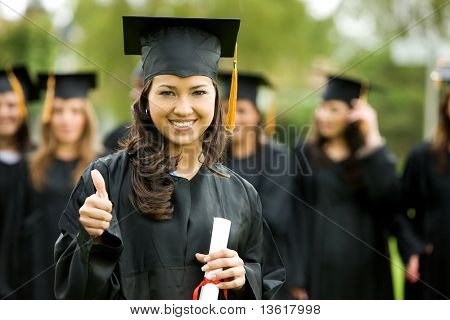 graduation girl holding her diploma with pride