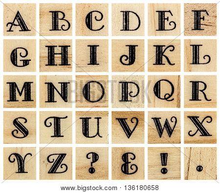 English alphabet uppercase collage of isolated wood letterpress printing blocks isolated on white background