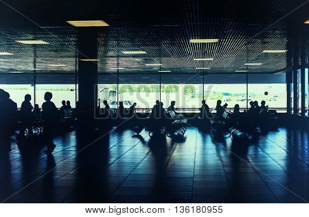 Toned photo of people are waiting for departure in the airport